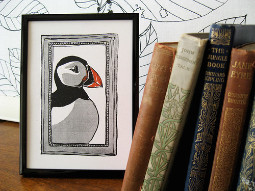 Young puffin and his books.