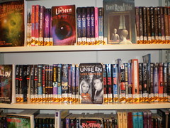 Horror paperback books are shelved together