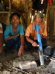 lahu tribesmen smokin' tobacco from a pvc pipe