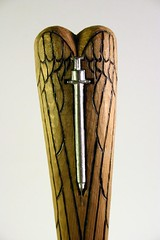 DarinMWhite HealingHeartInjectionFaithHope&Love 12Lx2.5Wx6.25D Detail Front View Carved&BurnedCedarCastLead