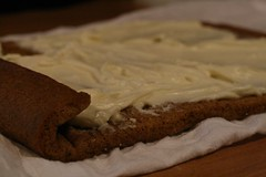 Unroll cooled cake and spread with cream cheese filling before rolling up again