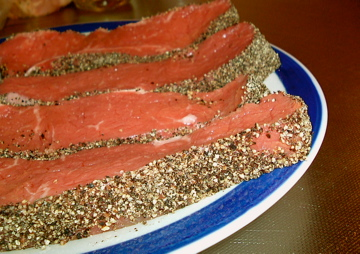Peppered steaks awaiting the grill