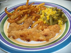Chicken strips, fries and green beans/corn