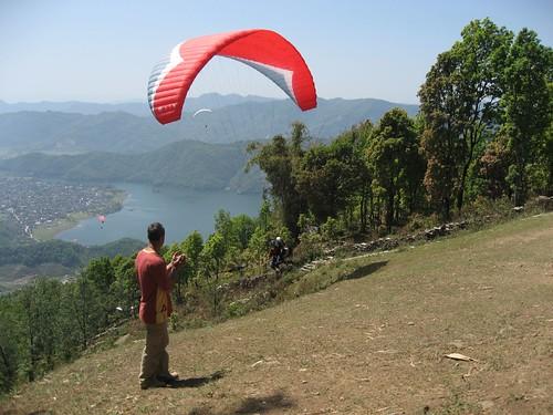 Xavier applauds a paraglider's take off