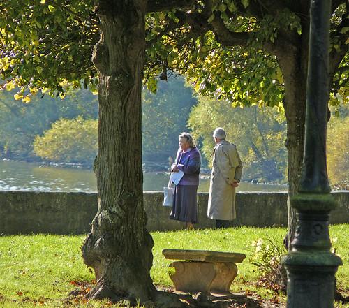 elders walking by the river Seine