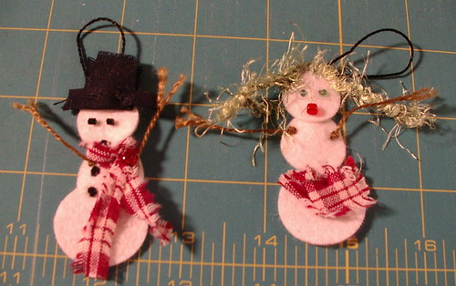 snow people with hangers