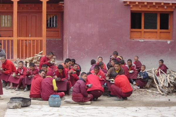 Monks having lunch in the monks quarters of Lo Manthang, Mustang