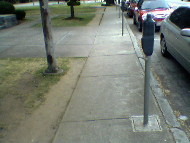 parking meters force people off the sidewalk
