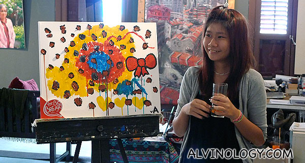 Angie with her artwork