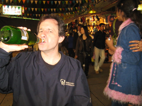 Billy drinking a beer at Temple Street.