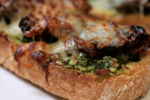 Pesto and cheese close up