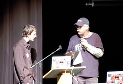 Article image: Joe Lien speaks on stage at the MLTI Student Conference with Jim Moulton, Education Development Executive for Apple.
