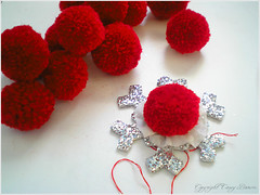 the red pom poms
