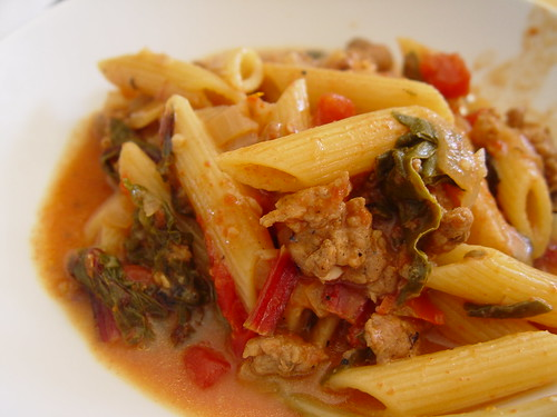 Pasta with sausage, tomatoes, and veggies