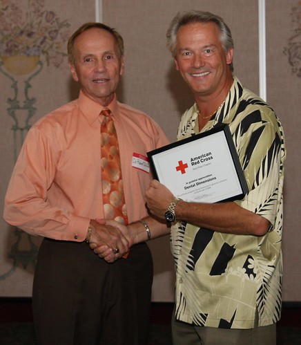 Dr. T of Dental Dimensions and Dr. Willis giving him his award.