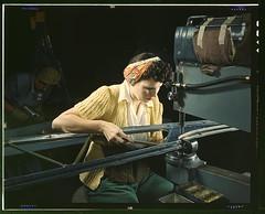 A Girl Riveting Machine Operator