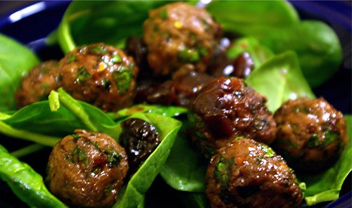 lamb meatballs with sour cherry sauce and spinach