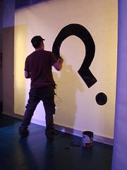 """Oscar Rodriguez paints the """"question mark"""" Unpredictable logo"""