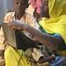 Aziza writing in book 2