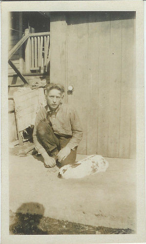 man with rabbit kneeling on the ground
