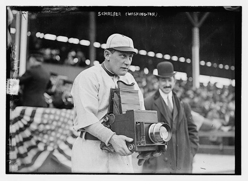 Baseball player holding a camera