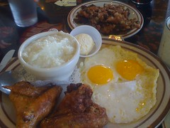 grits, eggs, fried chicken, and corned beef hash