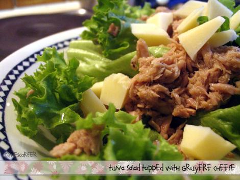 Tuna salad topped with gruyere cheese