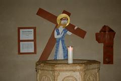 Jesus takes up his cross
