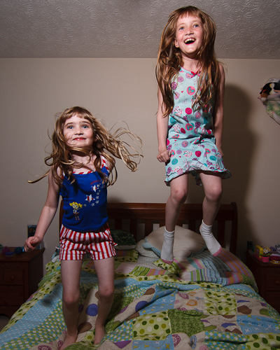 Two little monkeys, jumping on the bed...