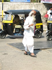 autorickshaw and holy man