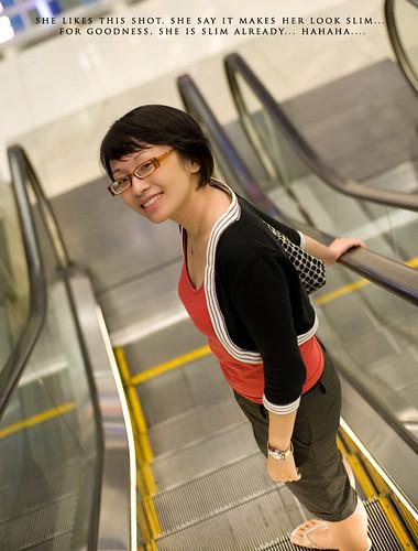 My dear at the escalator