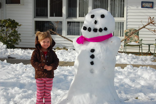 Gracie poses with the snowman she and Daddy made!!!