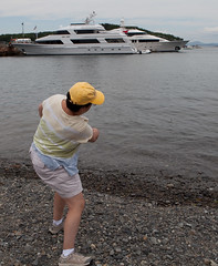 Lauri skips stones across the water