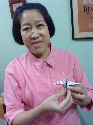 Paper Crane #16 | Emilia T. Boncodin served as Secretary of the Department of Budget and Management from 1998 to 2005. She earned her degree in Business Administration and Accountancy from the University of the Philippines and her Master in Public Administration, as Edward S. Mason Fellow, from the Kennedy School of Government, Harvard University, in 1986. She was an Eisenhower Exchange Fellow in 1996. She has been conferred three honorary doctorates: in humanities from the Central Luzon State University, in science form the Cavite State University, and in public administration from the Polytechnic University of the Philippines.