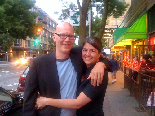 a dude on the street was kind enough to snap our picture after getting engaged on June 18, 2009
