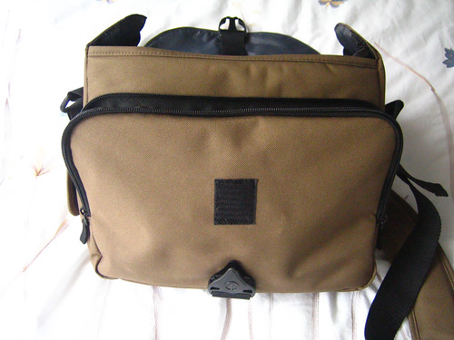 The front of the Tamrac with the flap open. You can see the square velcro and the front zippered compartment.