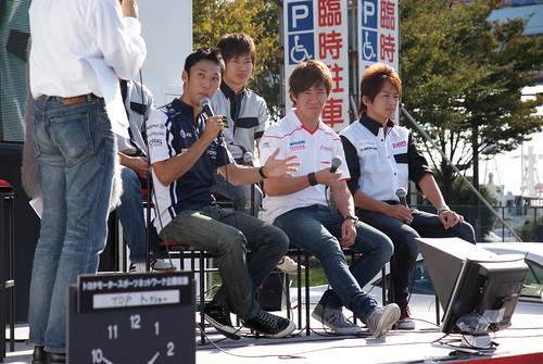 Kazuki Nakajima and Kamui Kobayashi speak to the crowd