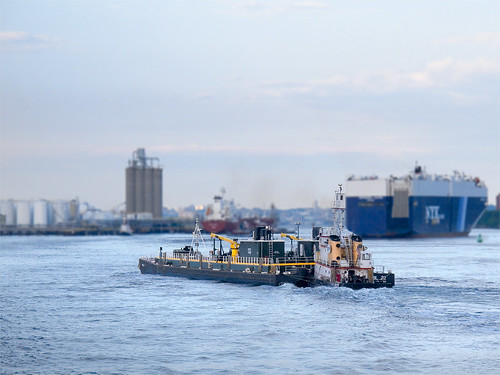 Tug and barge by you.