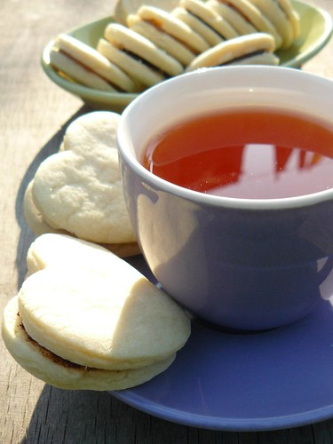 Tea with cookie sandwiches