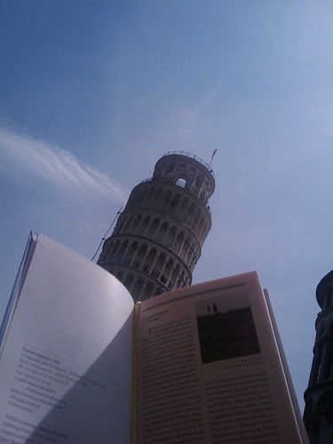 Reading by the leaning tower of pisa