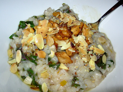 Arctic char and mushroom risotto with slivered almonds
