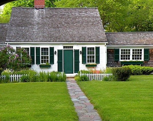 White clapboard house with green door in Osterville MA on Cape Cod