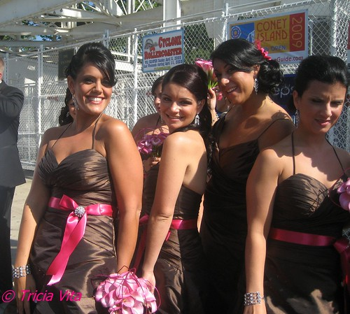 A bevy of bridesmaids in front of Coney Islands Cyclone Roller Coaster. Photo © Tricia Vita/me-myself-i via flickr
