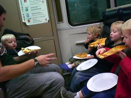 Pizza on the train after a long day in NYC