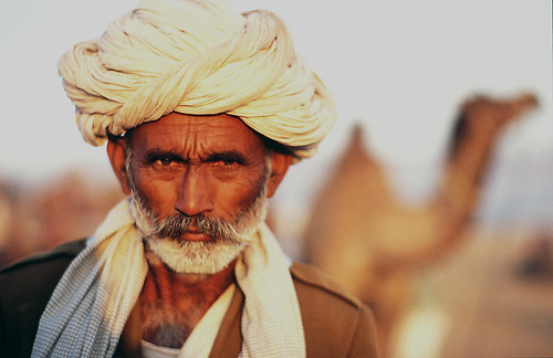 India Rajasthan Camel Trader Gipsy by mkleinmanns