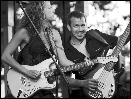 Ana Popovic shreds her guitar as bassist Ronald Zonker plays along at the Peace Park stage during the third annual Roots N Blues N BBQ Festival on Saturday, Sept. 26, 2009. Popovic hails from Yugoslavia and learned to play the guitar at age 15.