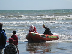 Photo of Santa arriving by boat at New Brighton