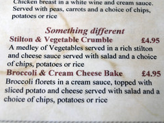Perhaps they were trying to entice people who are not vegetarian to eat these dishes, just to make it worth their while having them on the menu.
