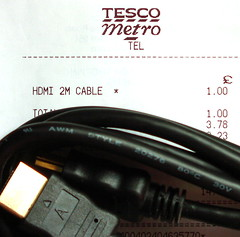 A cheap HDMI cable, with the receipt showing the price.