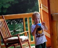 Joey enjoying a beverage on DCoy's porch